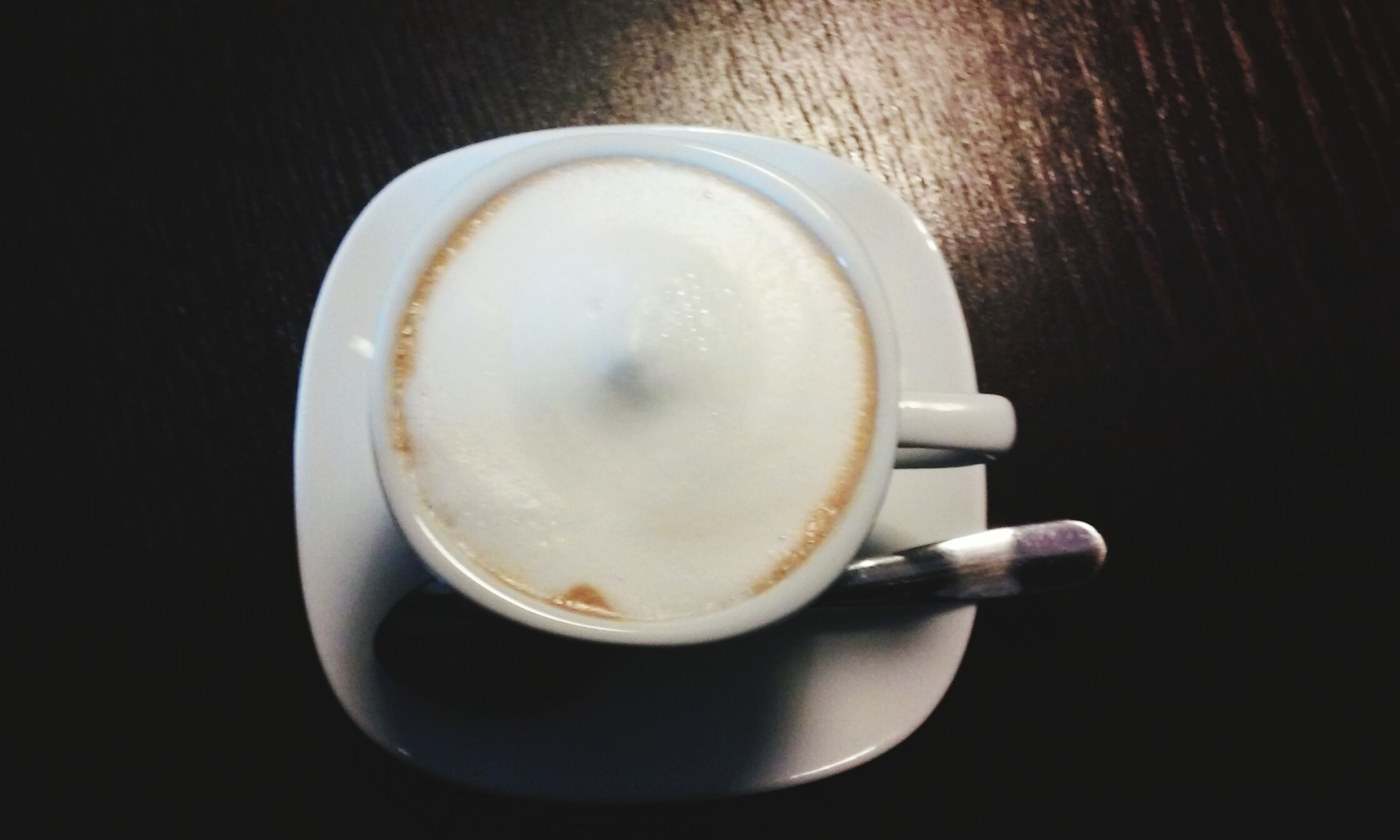 drink, food and drink, coffee cup, refreshment, coffee - drink, saucer, indoors, freshness, coffee, frothy drink, table, cup, still life, spoon, cappuccino, beverage, close-up, directly above, healthy eating, high angle view