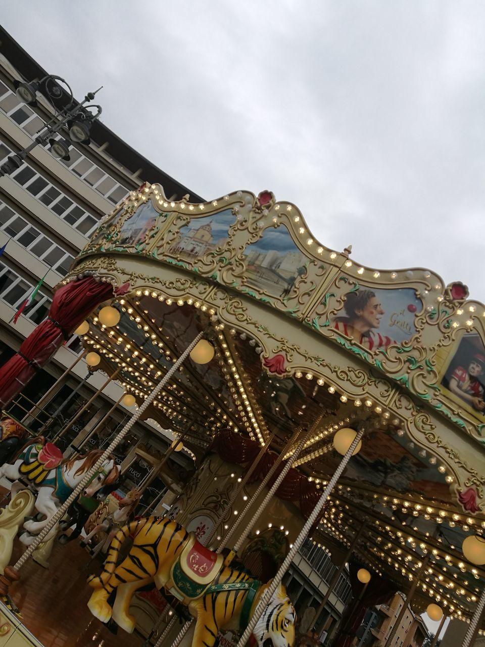 low angle view, built structure, architecture, building exterior, amusement park, no people, carousel, outdoors, day, sky, amusement park ride