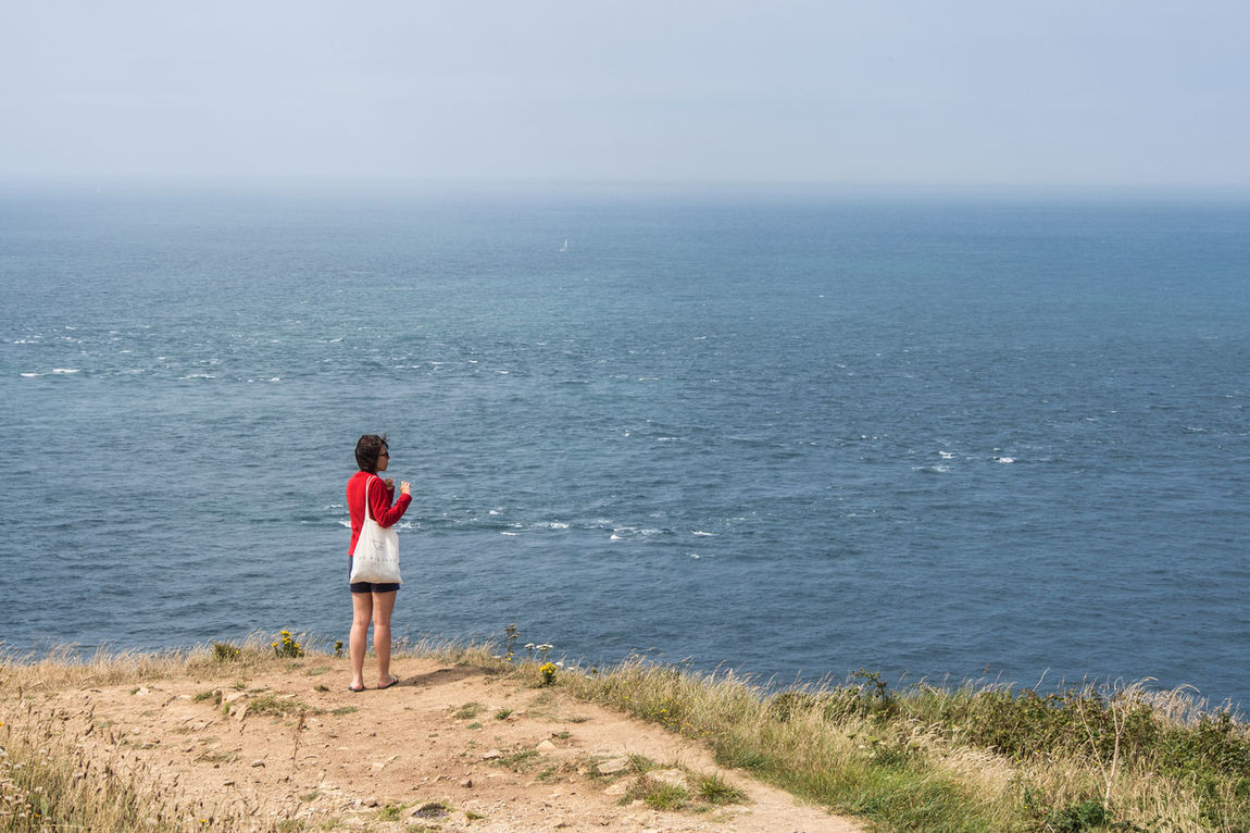 Atlantic Cape Town France Jobourg Nez De Jobourg Panoramic Red Beauty In Nature Beauty In Nature Casual Clothing Full Length Girl Horizon Over Water Lifestyles Nature Normandy One Person Outdoors Real People Sea Sea And Sky Sky Standing Young Adult Young Women