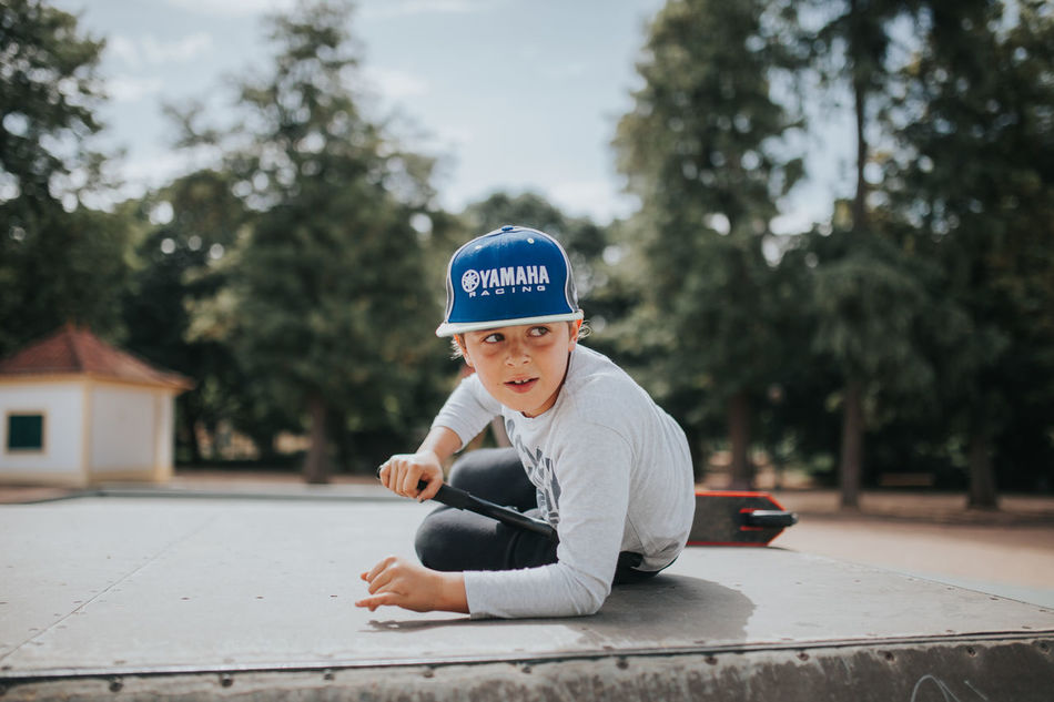 Best Of EyeEm Boys Cap Casual Clothing Child Childhood Day Kid Kids Being Kids Leisure Activity One Person Outdoors People Real People Sitting Skateboard Skateboarding Skatelife Skatepark Sky Tree WeekOnEyeEm