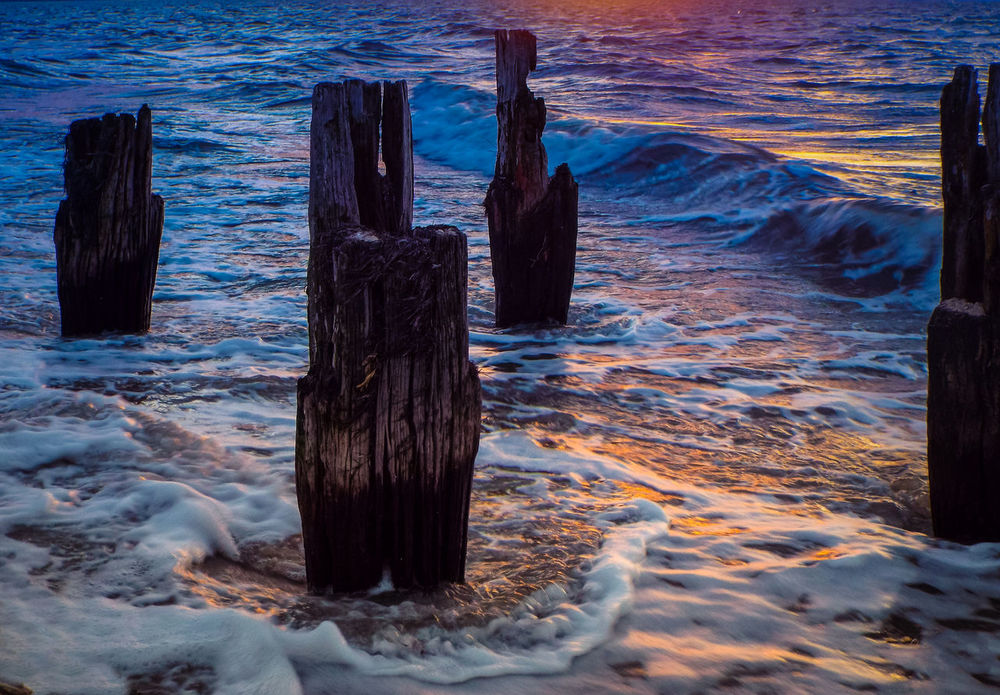 sunset decay Beach Beauty In Nature Bluehour Rotting Away Sea Sunset Sunset Photography Waves Waves, Ocean, Nature Wooden Post