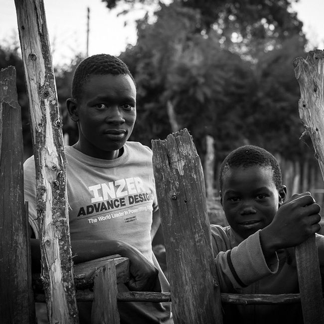 Boys at the fence in Eldama Ravine. These two young men were happy to have a chat with me. Both have dropped out of school because of a lack of money for school fees. It's so sad to see young people with huge potential facing such huge struggles. Africa Kenya Photooftheday Noschoolfees poverty portrait igkenya