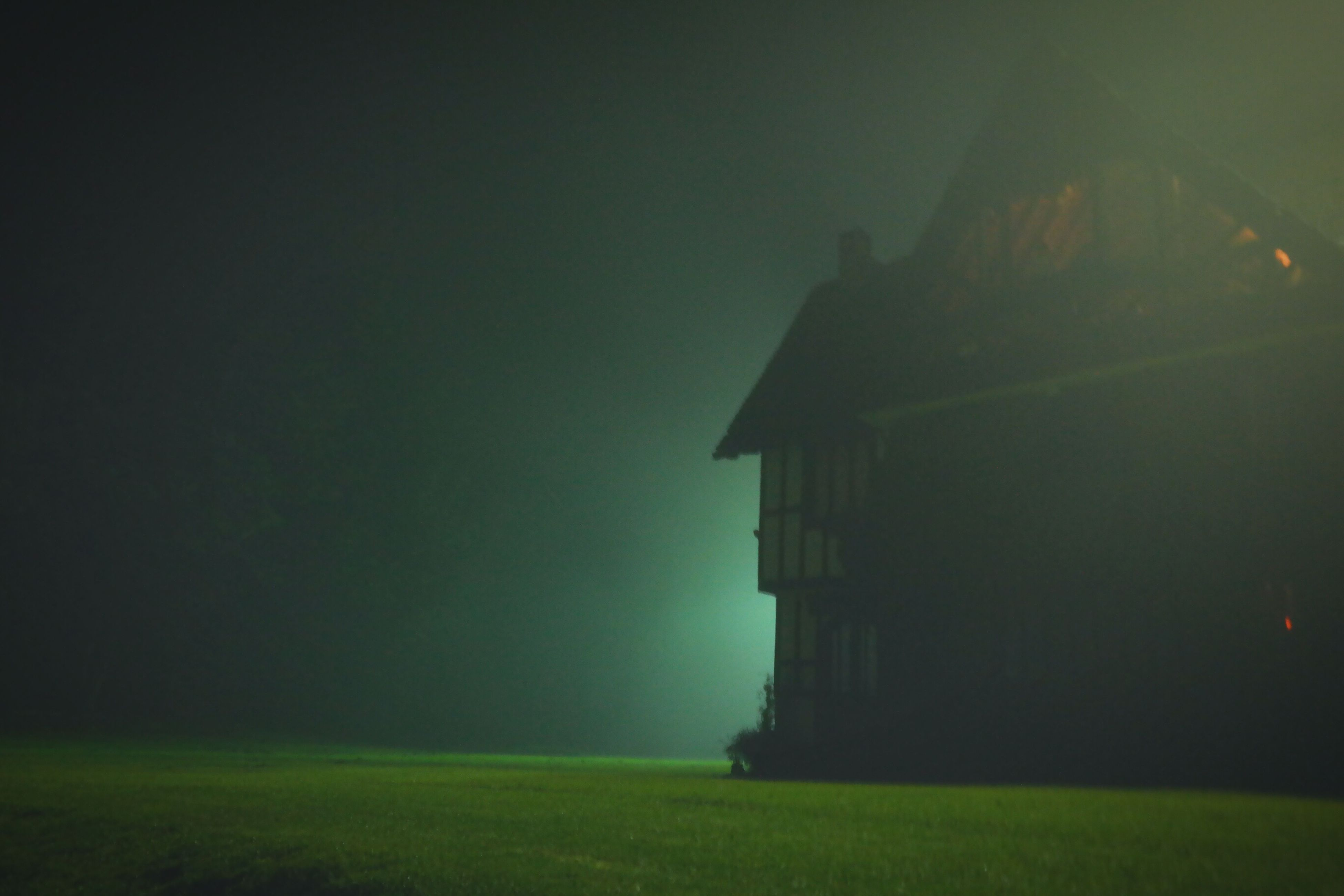 building exterior, architecture, built structure, grass, night, field, sky, copy space, dusk, house, green color, illuminated, landscape, outdoors, nature, no people, residential structure, clear sky, tranquility, grassy