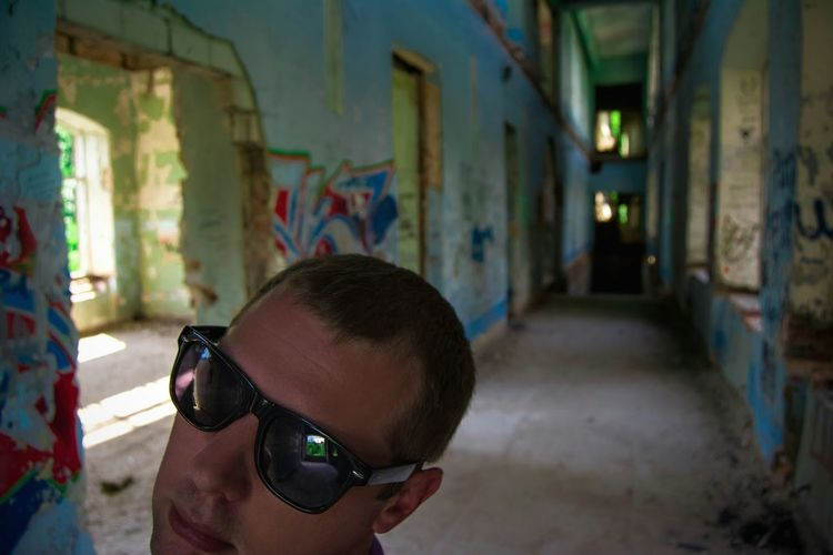 Self Portrait Eyeem Photo Indoors  Lifestyle From My Point Of View By Ivan Maximov Indoors  Our Best Pics Exceptional Photographs Abandoned Abandoned Places Portrait Of A Man  Lifestyles Atmospheric Scene Atmospheric Mood Thats Me  Portrait Wall Art Tranquility Freshness Looking At Me Eyeem Faces Sunglasses Hallway Reflection Breathing Space