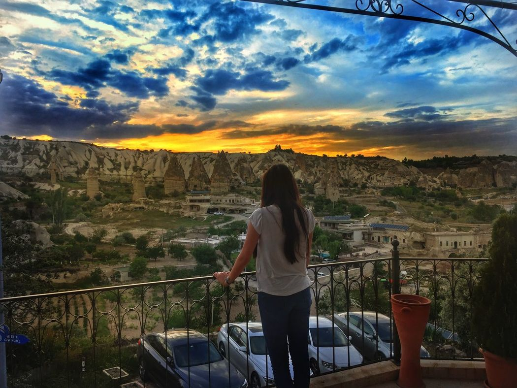 Rear View Person Sunset Leisure Activity Standing Lifestyles Casual Clothing Mountain Cloud - Sky Three Quarter Length Railing Looking At View Men Beauty In Nature Balcony Cityscape Sky Tranquility Scenics Mountain Range IPhoneography