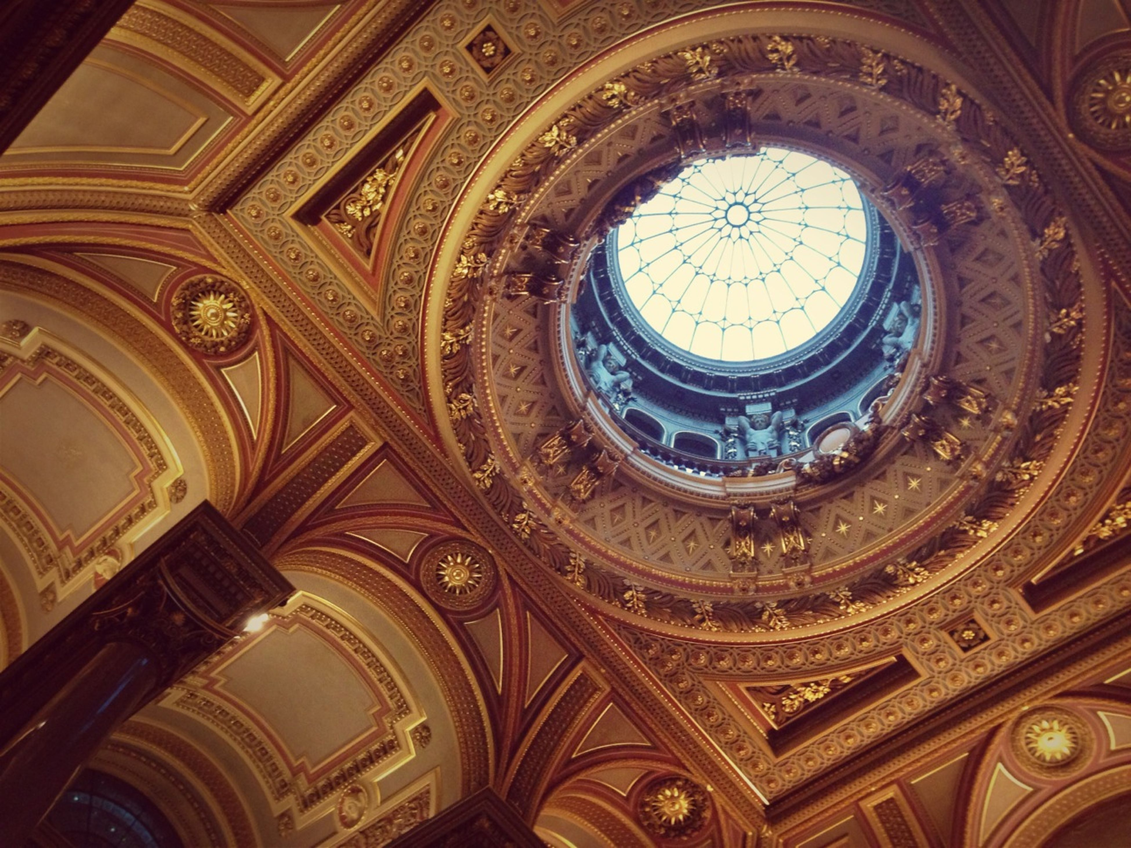 architecture, indoors, built structure, low angle view, ceiling, design, pattern, ornate, architectural feature, famous place, dome, place of worship, history, arch, religion, window, directly below, travel destinations, art and craft, spirituality