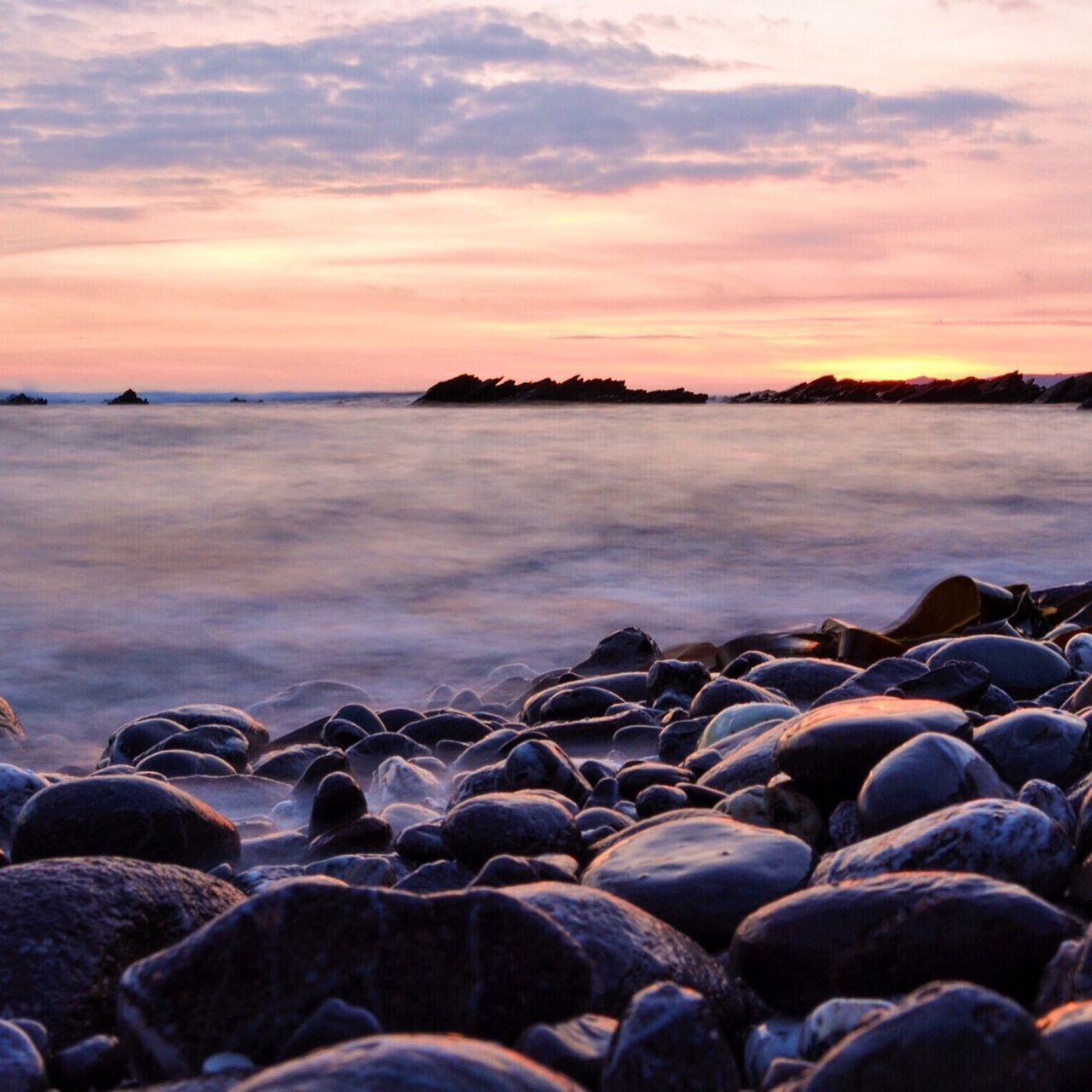 Sunset Water Scenics Tranquil Scene Sea Beauty In Nature Tranquility Idyllic Beach Shore Rock - Object Nature Remote Cloud - Sky Cloud Sky Ocean Non-urban Scene Calm