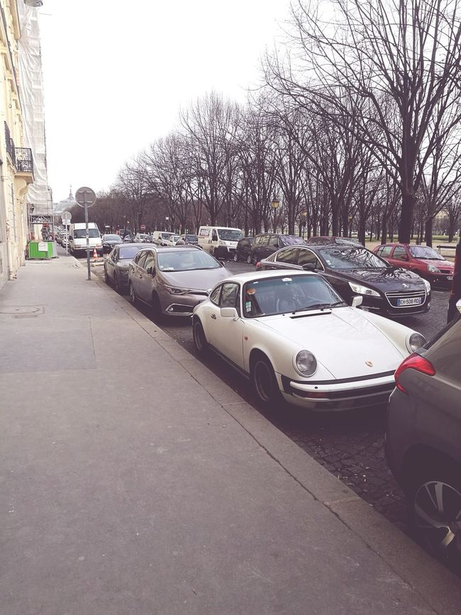 Porshe ,paris Car Tree Transportation Mode Of Transport Outdoors Sky No People City Water Day First Eyeem Photo