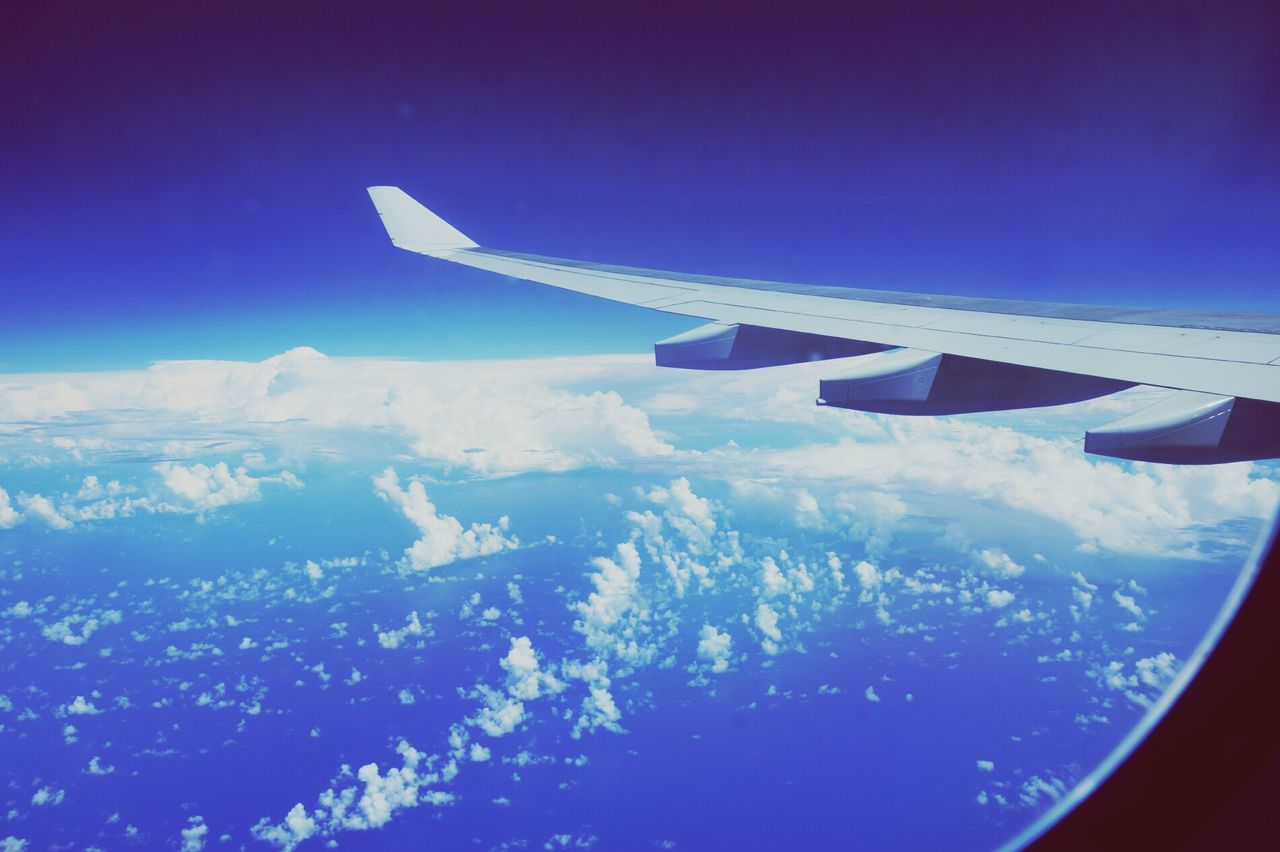 aerial view, journey, scenics, airplane, beauty in nature, nature, blue, transportation, sky, landscape, airplane wing, tranquil scene, majestic, travel, outdoors, mode of transport, air vehicle, no people, flying, day, tranquility, mid-air, the natural world, view into land