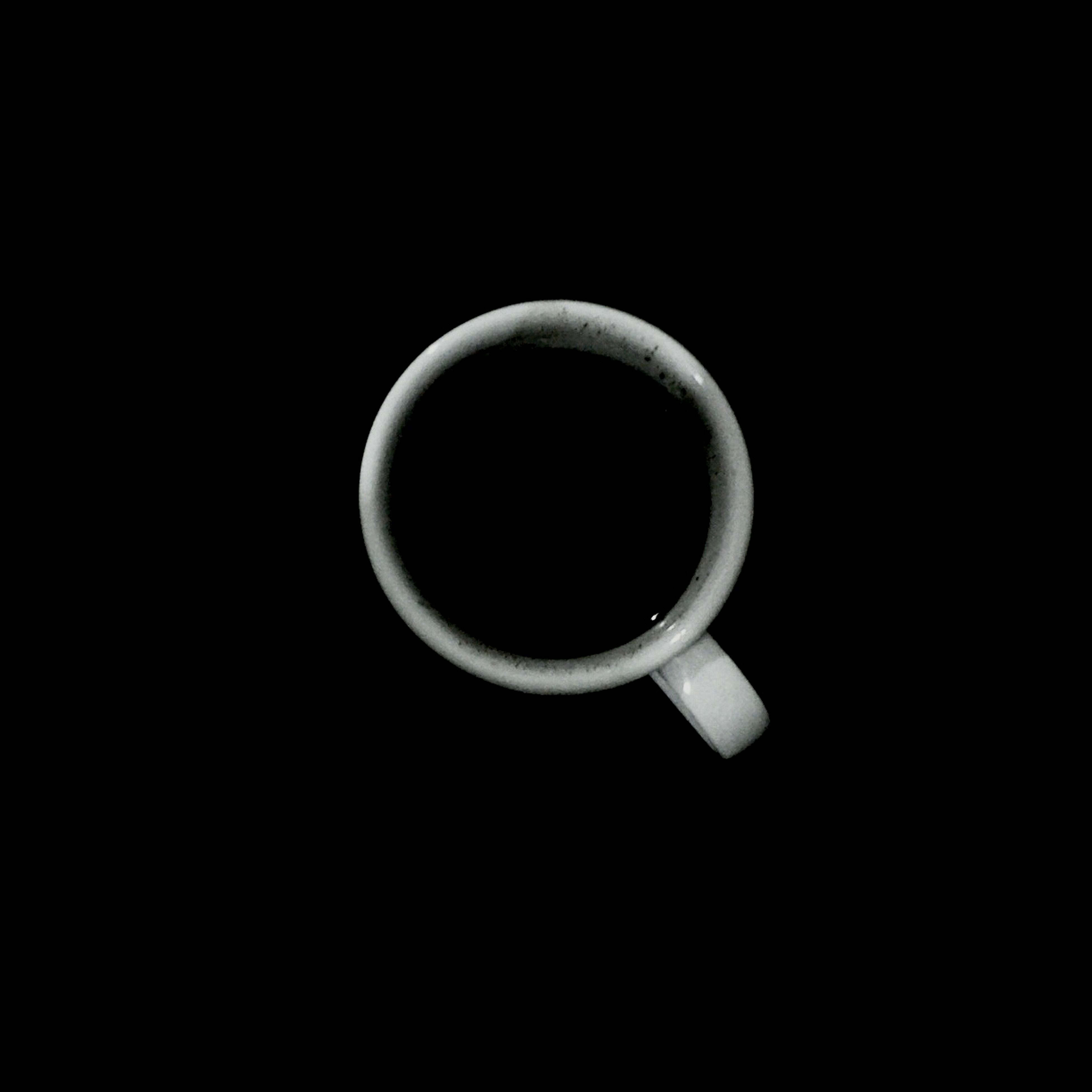 coffee cup, drink, studio shot, refreshment, cup, black background, food and drink, coffee, coffee - drink, still life, copy space, close-up, saucer, indoors, freshness, directly above, table, no people, tea, high angle view