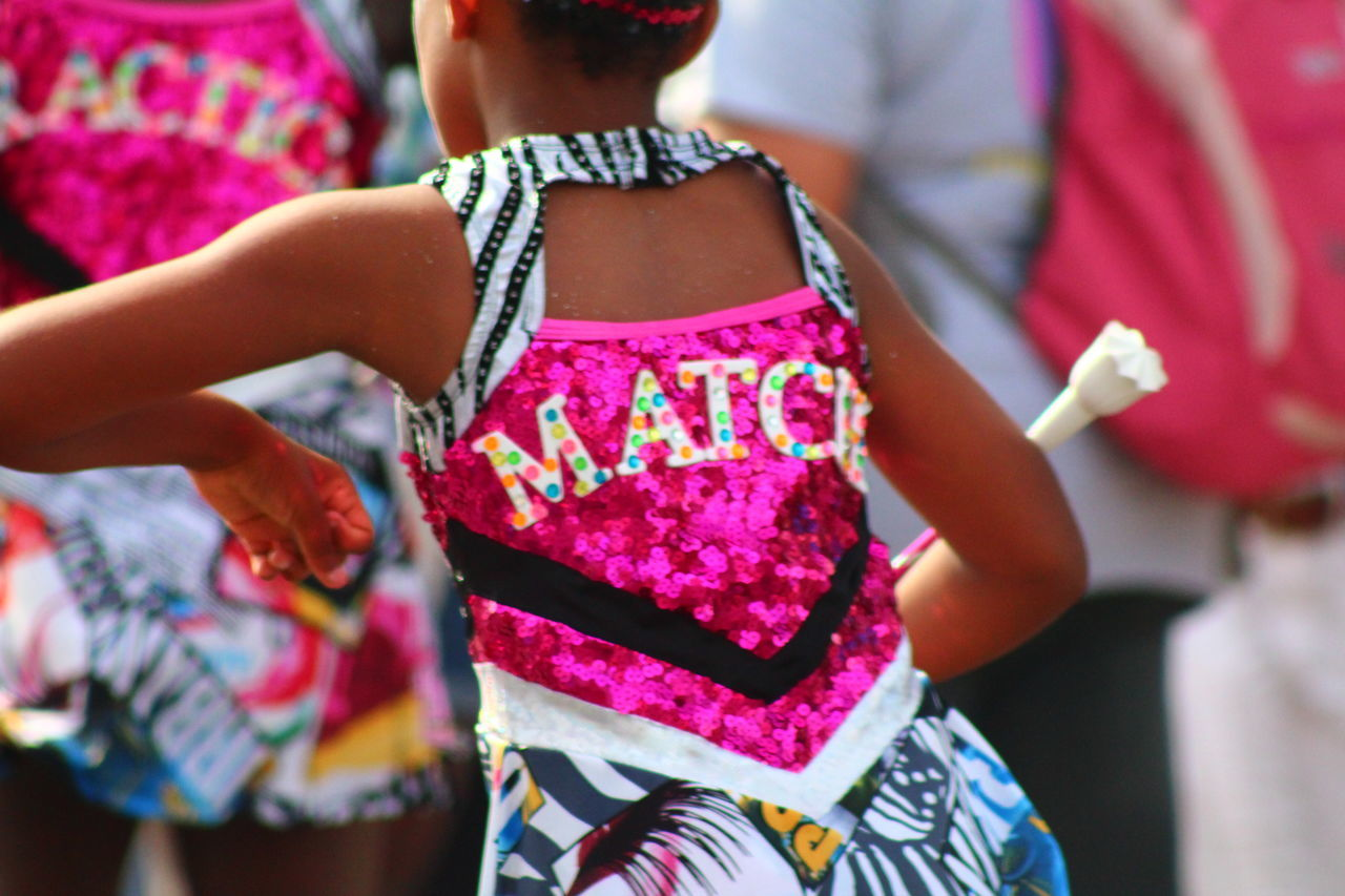 MATCH Bermuda Bermuda Day Celebration Childhood Cultures Dancers Day Friendship Girls Holi Leisure Activity Lifestyles Midsection Multi Colored Outdoors Parade Powder Paint Real People Rear View Standing Sunlight Togetherness Tradition Traditional Clothing Traditional Festival