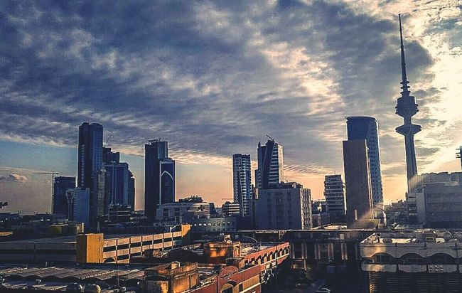 - Clouds suit my mood just fine 🗯💙 ( Urban Skyline City Skyscraper Travel Destinations Cityscape Building Exterior Dramatic Sky Downtown District Cloud - Sky No People Sky Evening Sky Sunset Sunset And Clouds  Love Kuwait City Moody Sky Mood Mood Of The Day )