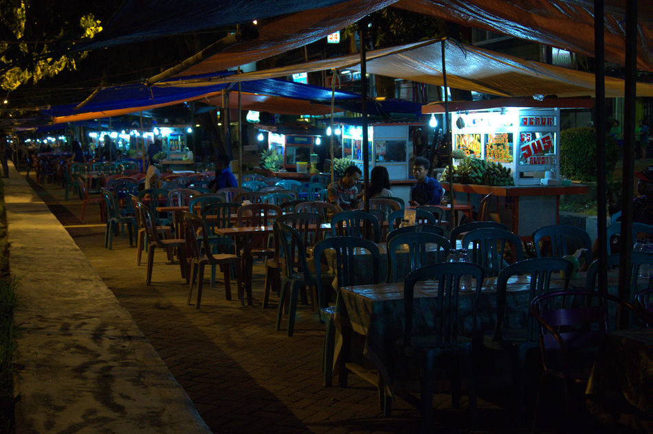 Traditional Food court in Makassar, Indonesia... We call it Pisang Epe' Cities At Night Makassar In Indonesia Makassarcity Losari Beach Makassarjajananpasar Foodcourt City At Night Citytrip City Lights At Night