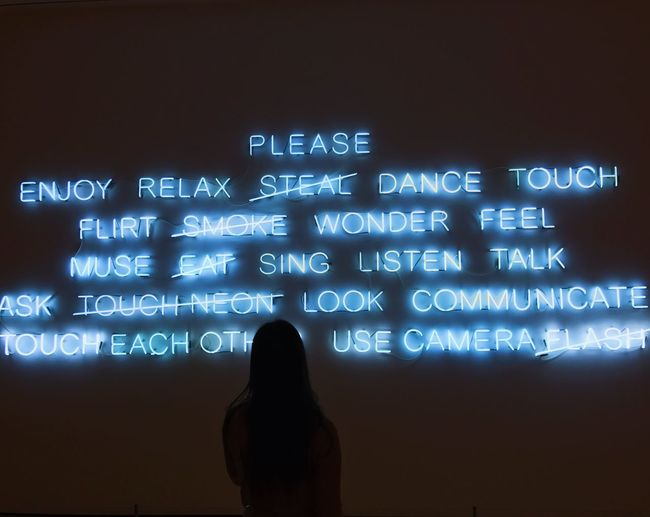 Silhouette One Person Text Indoors  Museum Art Inspirational Neon Light And Shadow Lights Woman Boston USA English Blue Words Phrases First Eyeem Photo