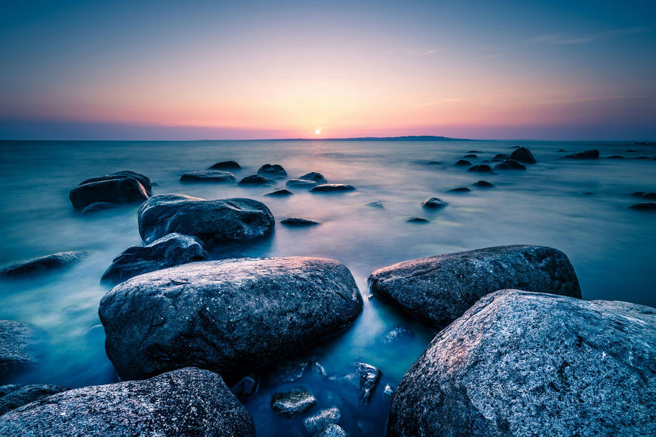 Stepping stones to eternity. Sunset Sea Water Horizon Over Water Tranquil Scene Scenics Rock - Object Beach Tranquility Beauty In Nature Vacations Idyllic Travel Destinations Tourism Nature Sun Majestic Rock Formation Sweden Travel Non-urban Scene Ocean Hano