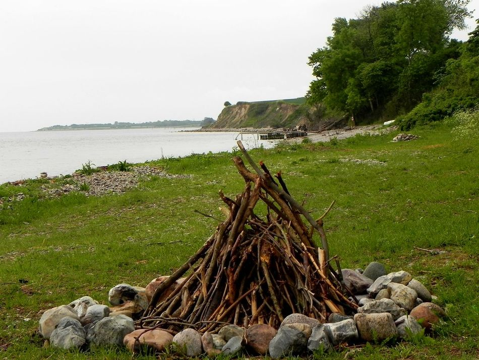 Danmark Outdoors Nature Wood - Material Day No People Grass Water Tranquility Beauty In Nature Sky Sea Stoney Beach Beachphotography Tranquil Scene Preparing Camp Fire!!!!