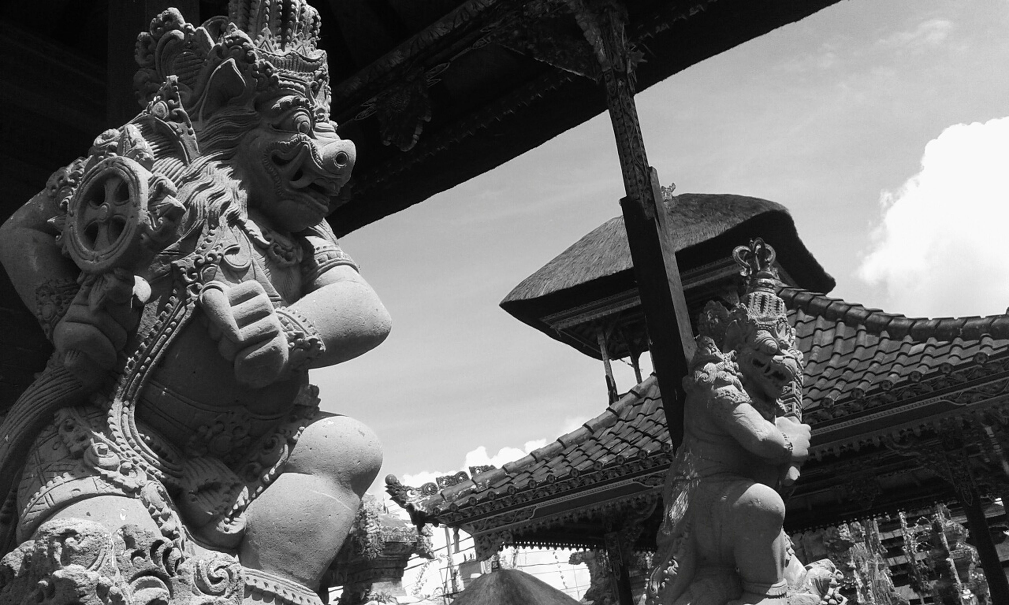 religion, low angle view, place of worship, spirituality, temple - building, sculpture, famous place, sky, statue, built structure, art and craft, architecture, travel destinations, tourism, art, travel, history, cultures
