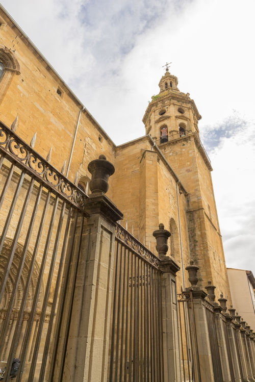 Puente La Reina Architecture Bell Tower Building Exterior Built Structure Camino De Santiago Clock Tower Cloud - Sky Day History Low Angle View No People Outdoors Place Of Worship Religion Road To Santiago Sculpture Sky Spirituality Statue
