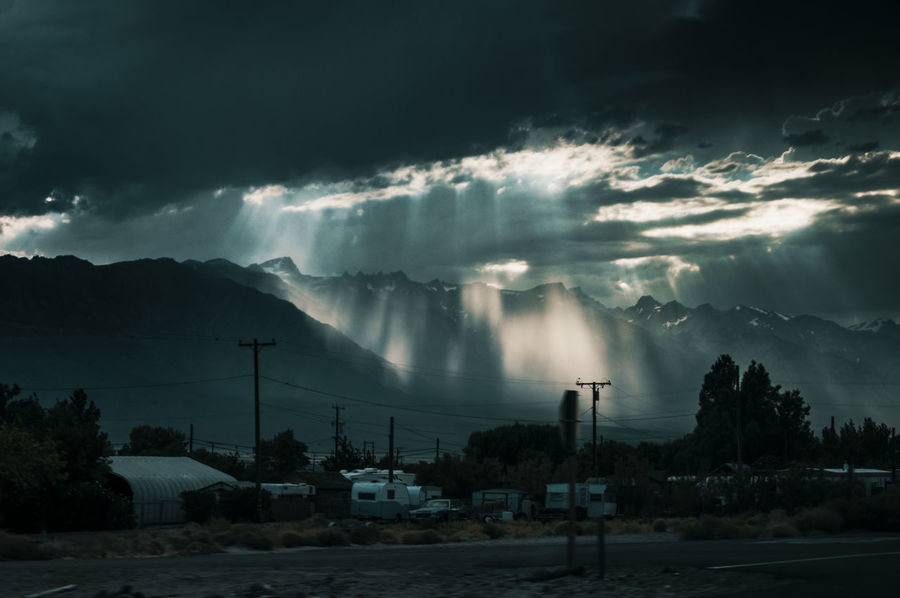 Dark Derelict Dramatic Sky Rain Beauty In Nature Cloud - Sky Dramatic Sky Electricity Pylon Gloomy Gloomy Weather Mountain Mountain Range Mountains Nature Outcast Outdoors Power In Nature Scenics Sierra Nevada Sky Storm Storm Cloud Thunderstorm Town Weather Lost In The Landscape