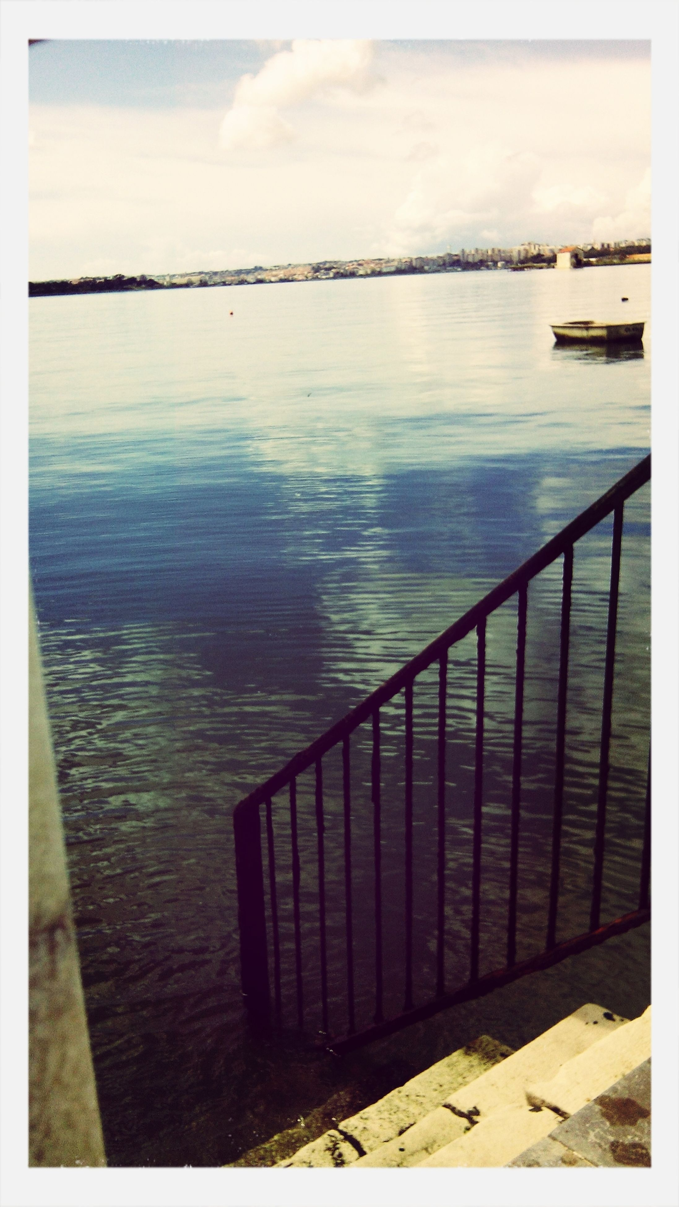 water, transfer print, auto post production filter, lake, sky, reflection, tranquility, tranquil scene, river, railing, sea, scenics, rippled, nature, pier, beauty in nature, cloud - sky, no people, day, outdoors