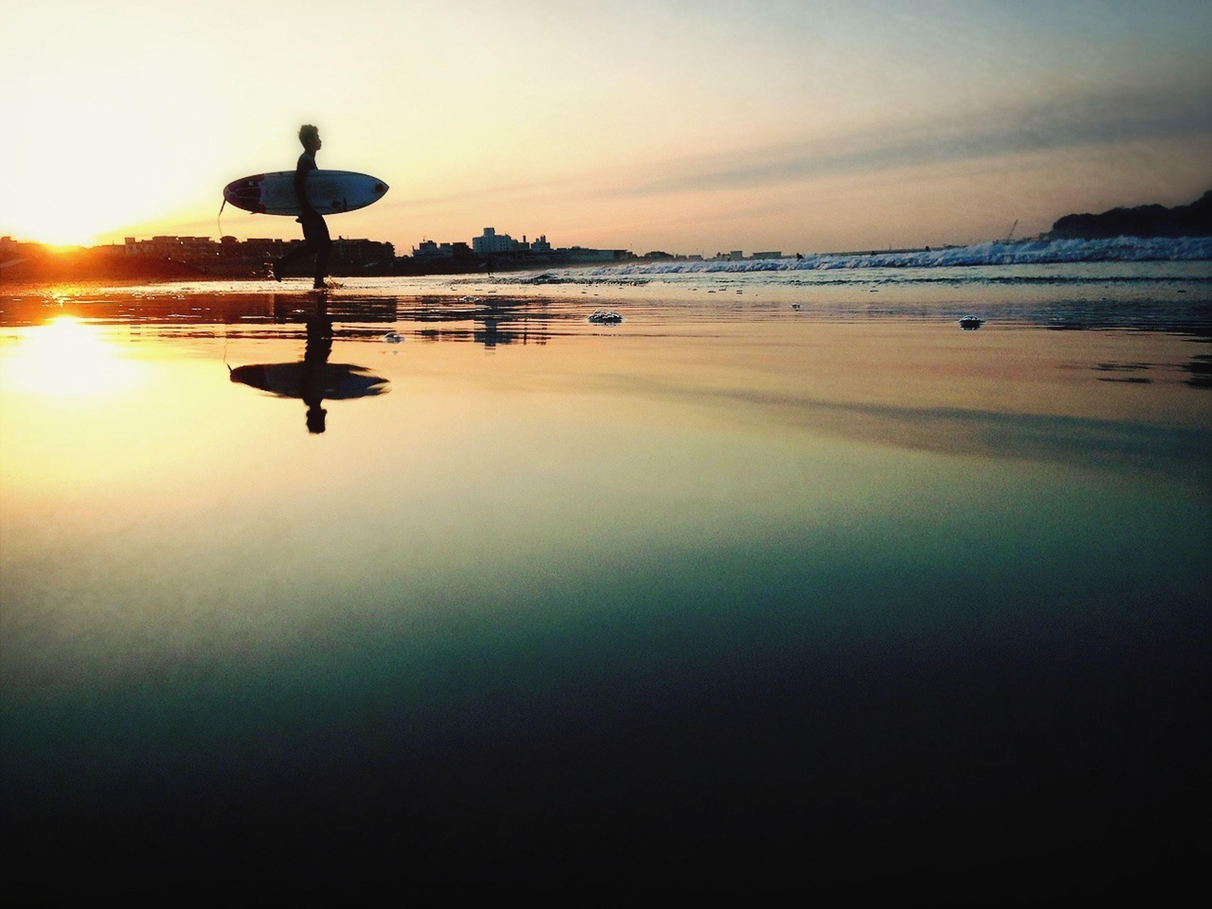 sunset, water, sea, sky, silhouette, sun, scenics, tranquility, tranquil scene, beauty in nature, horizon over water, reflection, idyllic, nature, orange color, beach, cloud - sky, street light, shore, sunlight