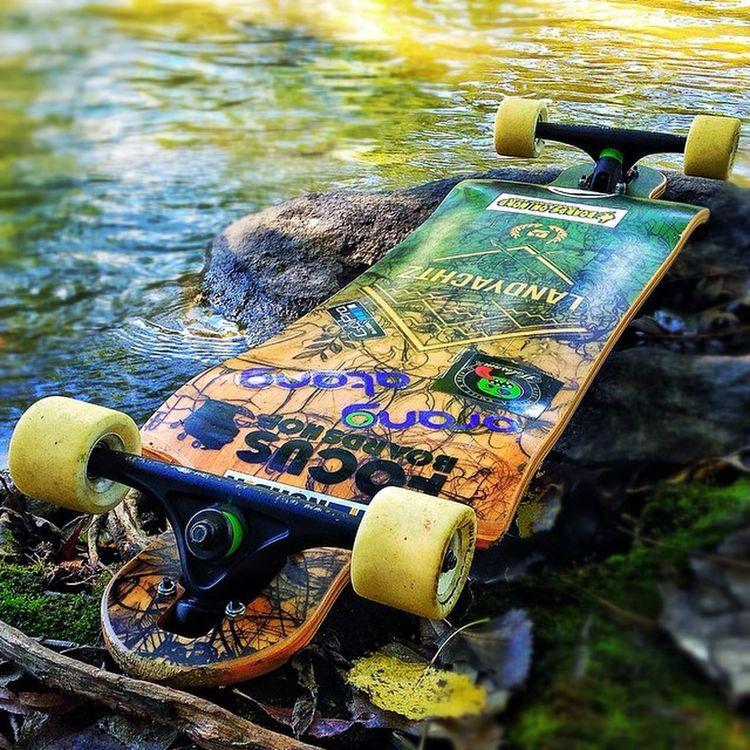 A Cool shot of my Landyachtzswitchblade by the river-walk! Longboard Longboards Longboarder Longboarding Longboardsoapbox Holesom Holesomslidepucks Holesompucks Sector9butterballs