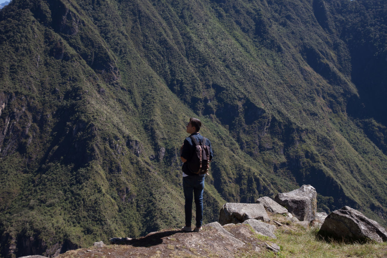 real people, mountain, one person, standing, full length, hiking, rock - object, leisure activity, nature, day, lifestyles, outdoors, casual clothing, backpack, hiker, scenics, landscape, mountain range, adventure, beauty in nature, one man only, young adult, only men, adult, adults only, people