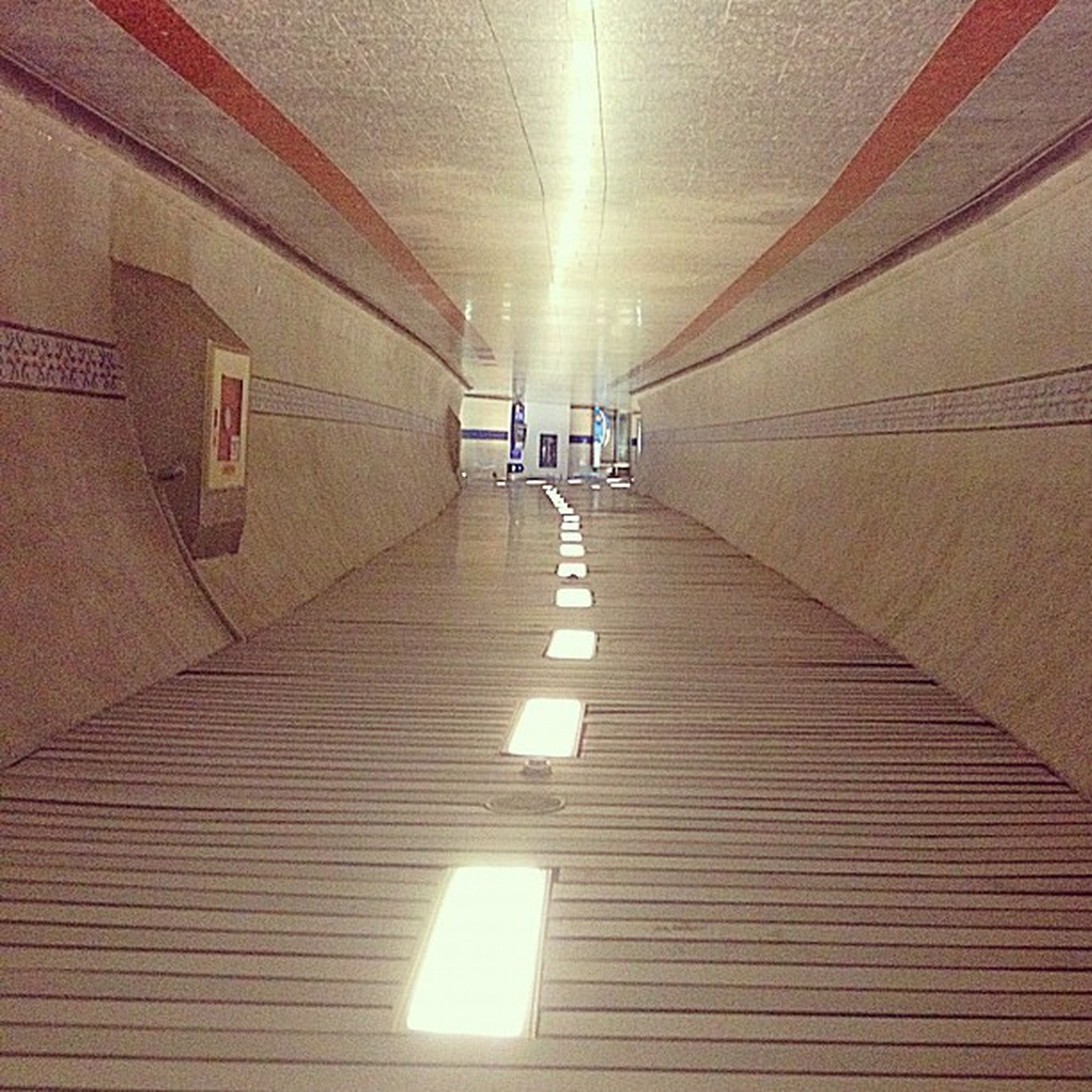 the way forward, indoors, architecture, built structure, ceiling, diminishing perspective, illuminated, empty, vanishing point, lighting equipment, corridor, wall - building feature, building, narrow, absence, flooring, tiled floor, wall, sunlight, tunnel