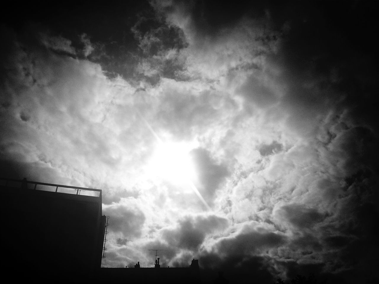sky, low angle view, cloud - sky, no people, silhouette, beauty in nature, outdoors, nature, day