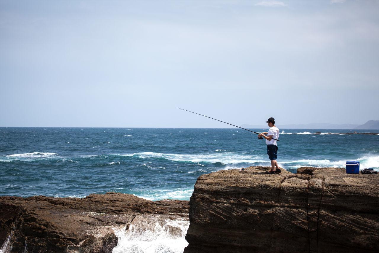 Beautiful stock photos of angeln, sea, full length, standing, horizon over water
