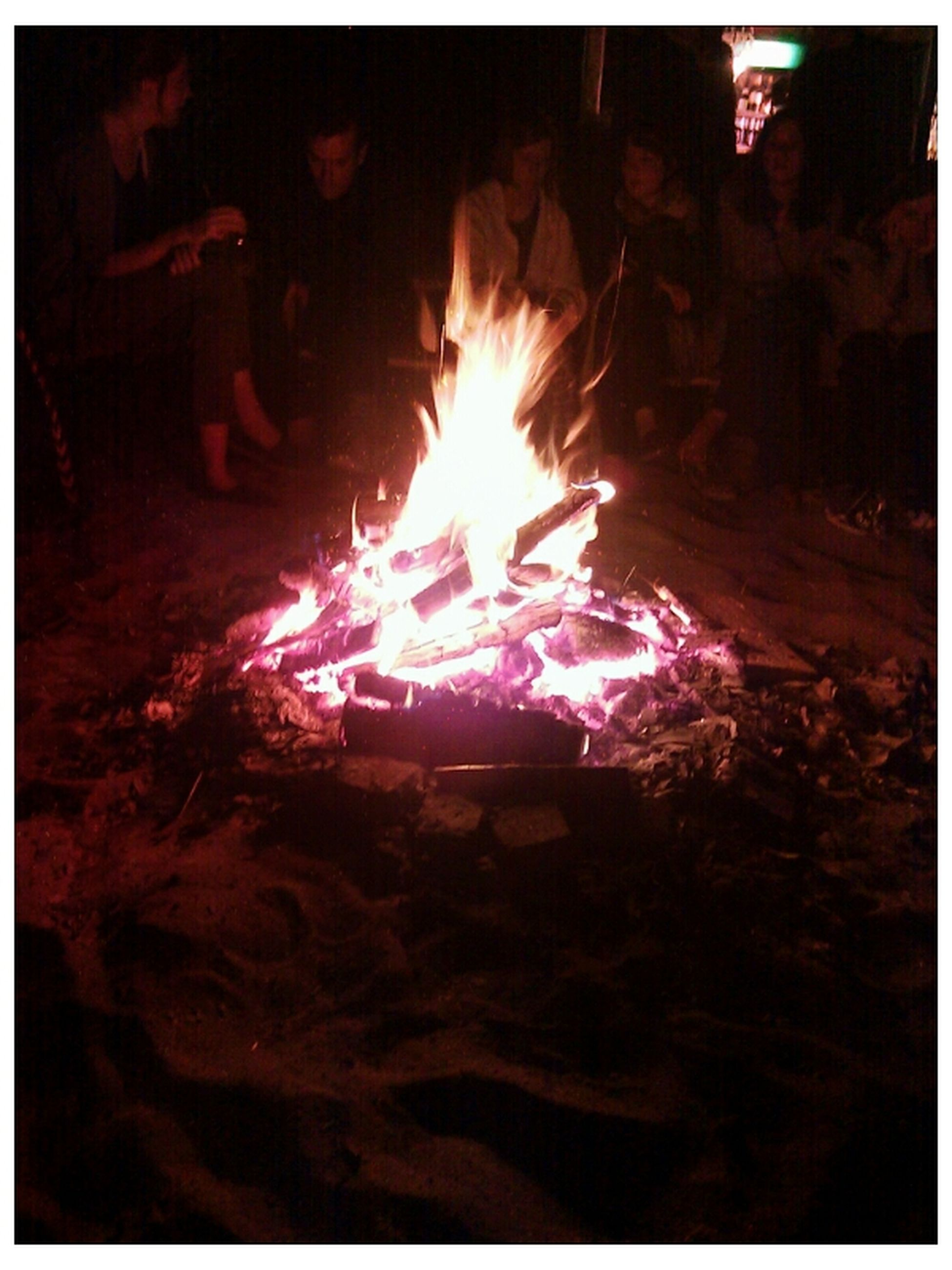 transfer print, night, fire - natural phenomenon, burning, auto post production filter, flame, glowing, illuminated, heat - temperature, bonfire, firewood, fire, dark, light - natural phenomenon, outdoors, no people, motion, high angle view, campfire, heat