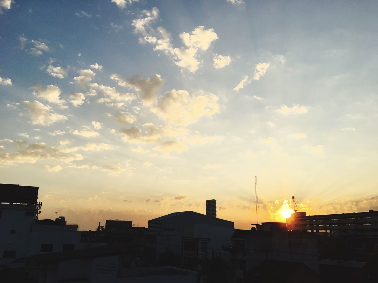 building exterior, architecture, built structure, sunset, sky, cloud - sky, city, no people, outdoors, cityscape, day