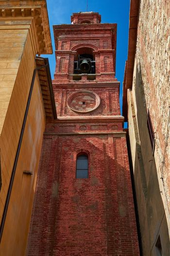Colourful architecture of Castiglione del Lago, Umbria Italy Umbria Castiglione Del Lago Bell Tower Tower Church Architecture Building Building Exterior Lookingup Vivid Colorful Weathered Textures And Surfaces Urban Town Historical Building No People Bell Brick Lines