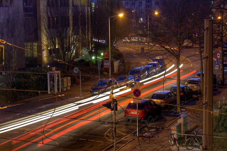 Leuchtspur 2 Architecture Built Structure City City Life Evening Evening Light Illuminated Light Tracks Motion Night Night Lights No People Outdoors Road Street Light Streetphotography Transportation