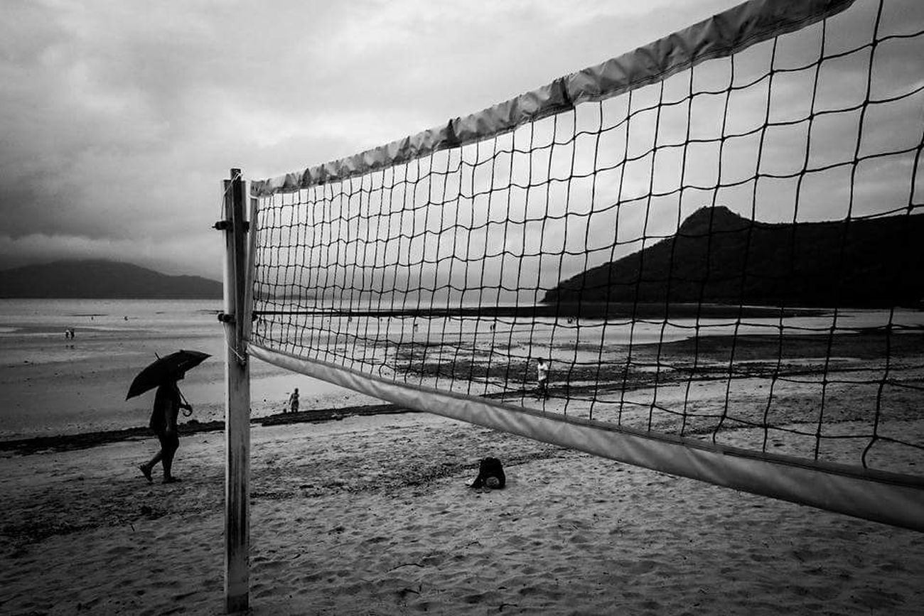 Tropical rain Fujifilm X70 Australia Streetphotography Street Photography Australia EyeEm Best Shots Beach Sea Sand Beach Volleyball Water Horizon Over Water Photooftheday People Photography The Street Photographer - 2016 EyeEm Awards Blackandwhite Photography Monochrome Photography Photographie  Hamiltonisland