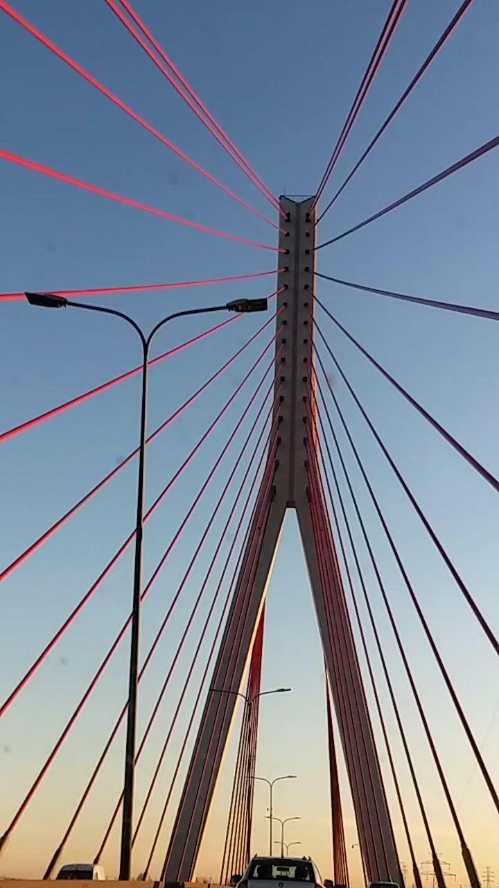 connection, bridge - man made structure, suspension bridge, architecture, engineering, transportation, built structure, cable, travel, travel destinations, outdoors, low angle view, bridge, tourism, sky, city, no people, day, line, chain bridge