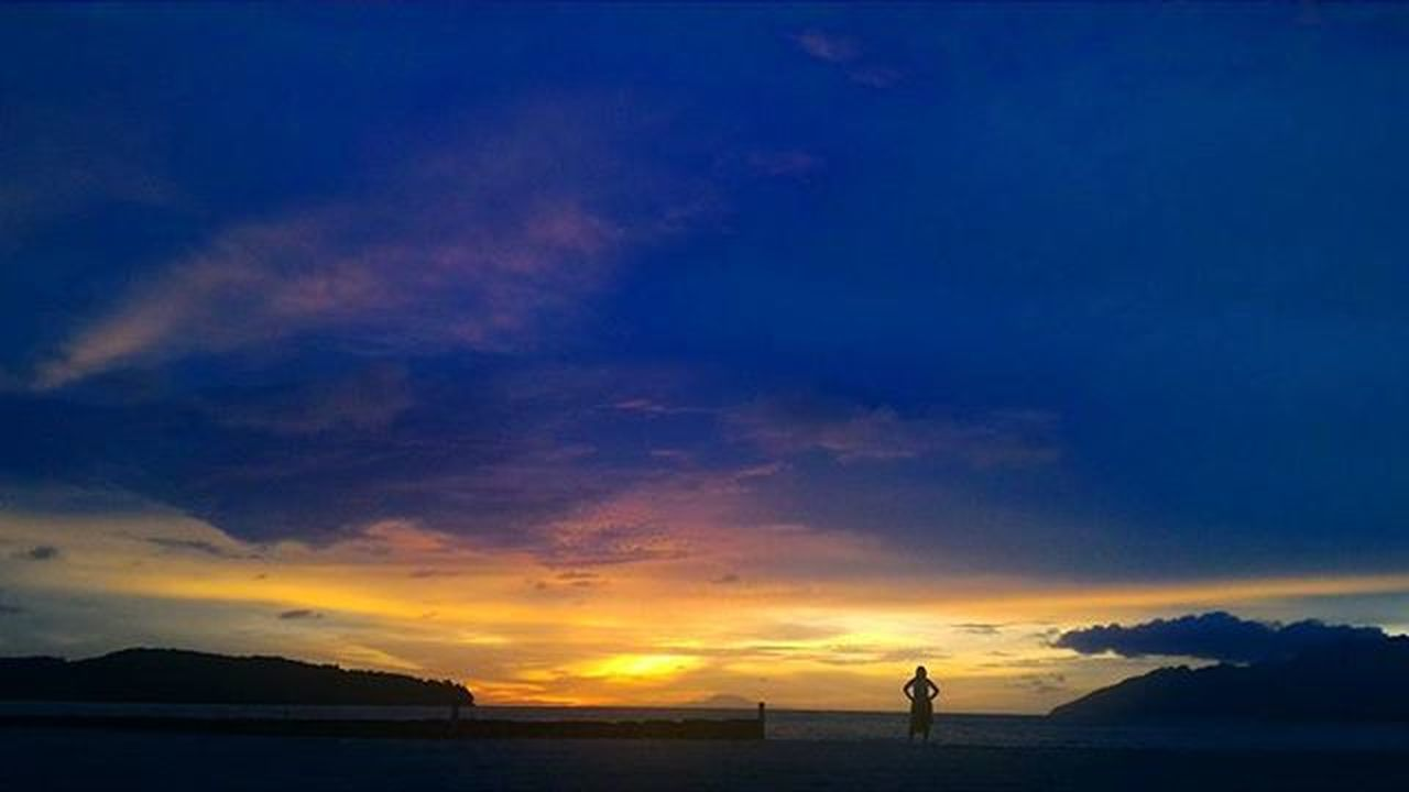 sunset, silhouette, scenics, sky, outdoors, one person, one man only, cloud - sky, nature, night, beauty in nature, landscape, adult, people, mountain, only men, adults only, sea, astronomy
