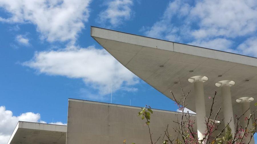 Cloud - Sky Architecture Building Exterior Built Structure Outdoors Modern Sky Day No People City Blue White Clouds Plant Structure Structure And Nature Bonn Minimalist Architecture Low Angle View Cityscape Museum Bundeskunsthalle Bundeskunsthalle Bonn Bundeskunstmuseum Facades