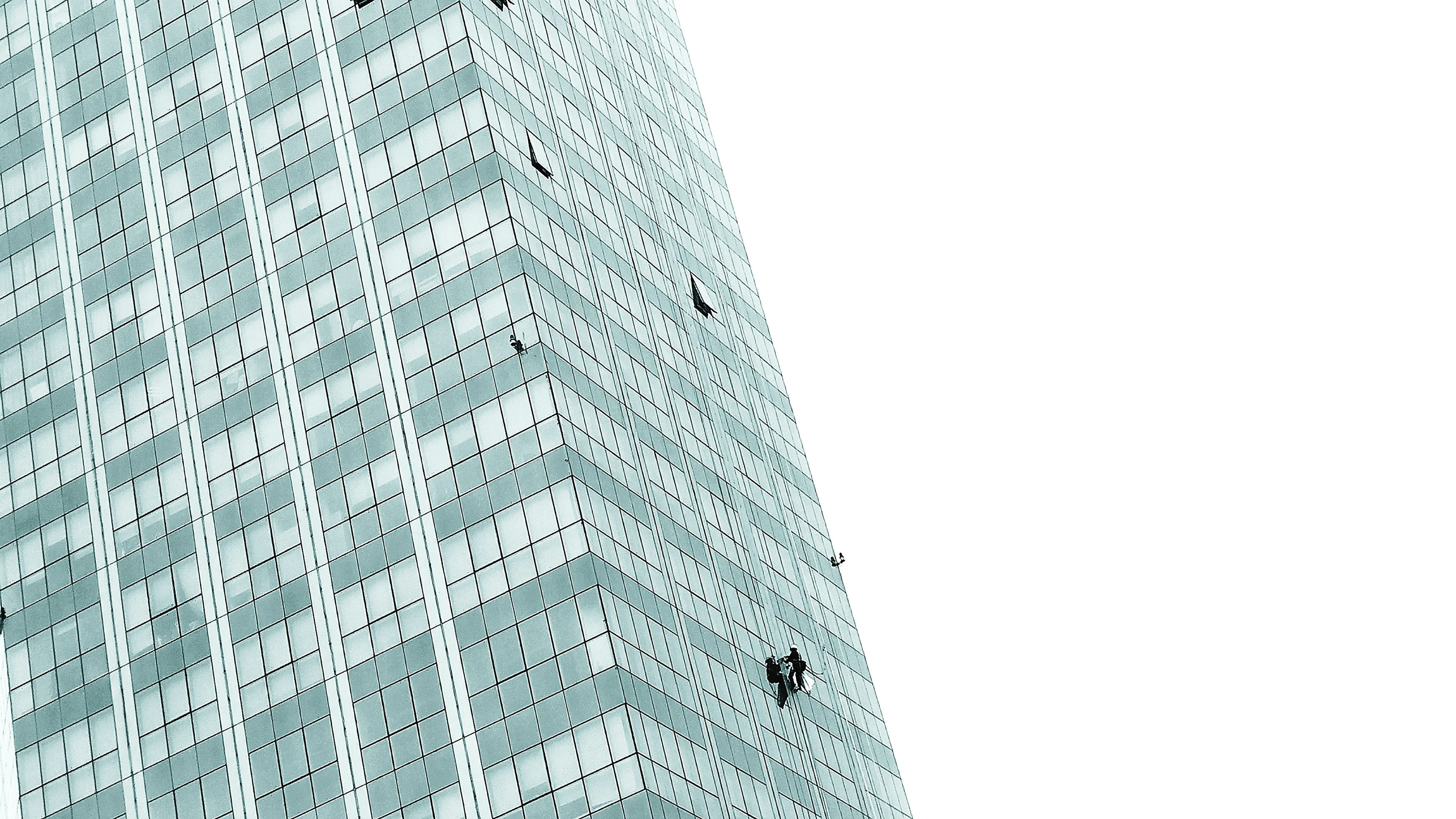 low angle view, pattern, architecture, building exterior, built structure, no people, white background, skyscraper, day, outdoors