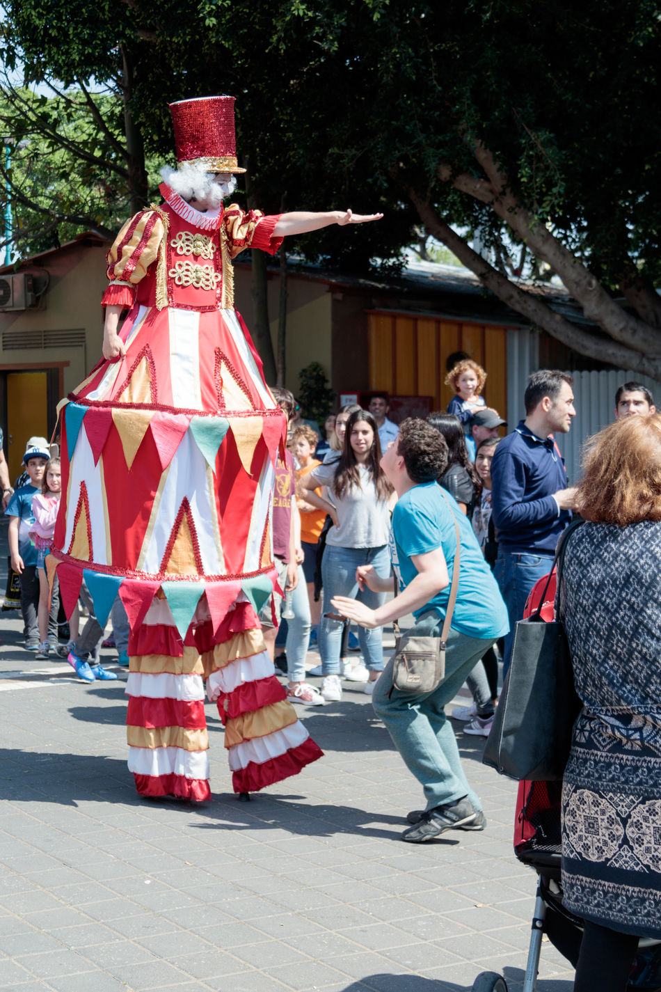 Tel Aviv, Israel, April 16, 2016 : Clown on stilts greets visitors to the attractions park in Tel Aviv, Israel Amusement  Attraction Beautiful Carnival Clown Costume Day Entertainment Event Face Festival Fun Funny Happiness Happy Holiday Joy Light Outdoors Park People Performer  Romantic Smile Stilt