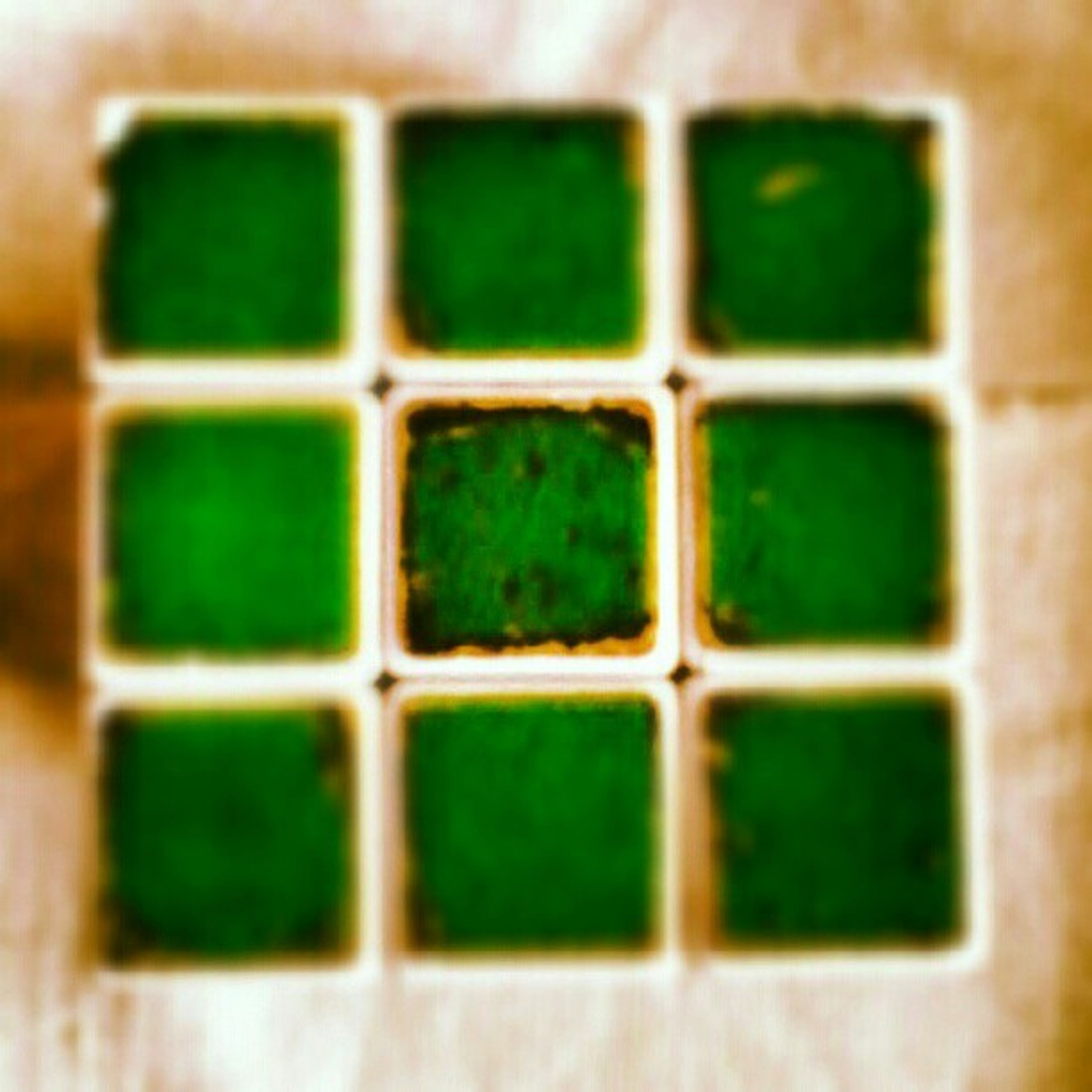 full frame, backgrounds, indoors, geometric shape, green color, pattern, close-up, square shape, textured, shape, multi colored, window, no people, design, repetition, glass - material, selective focus, detail, still life, in a row