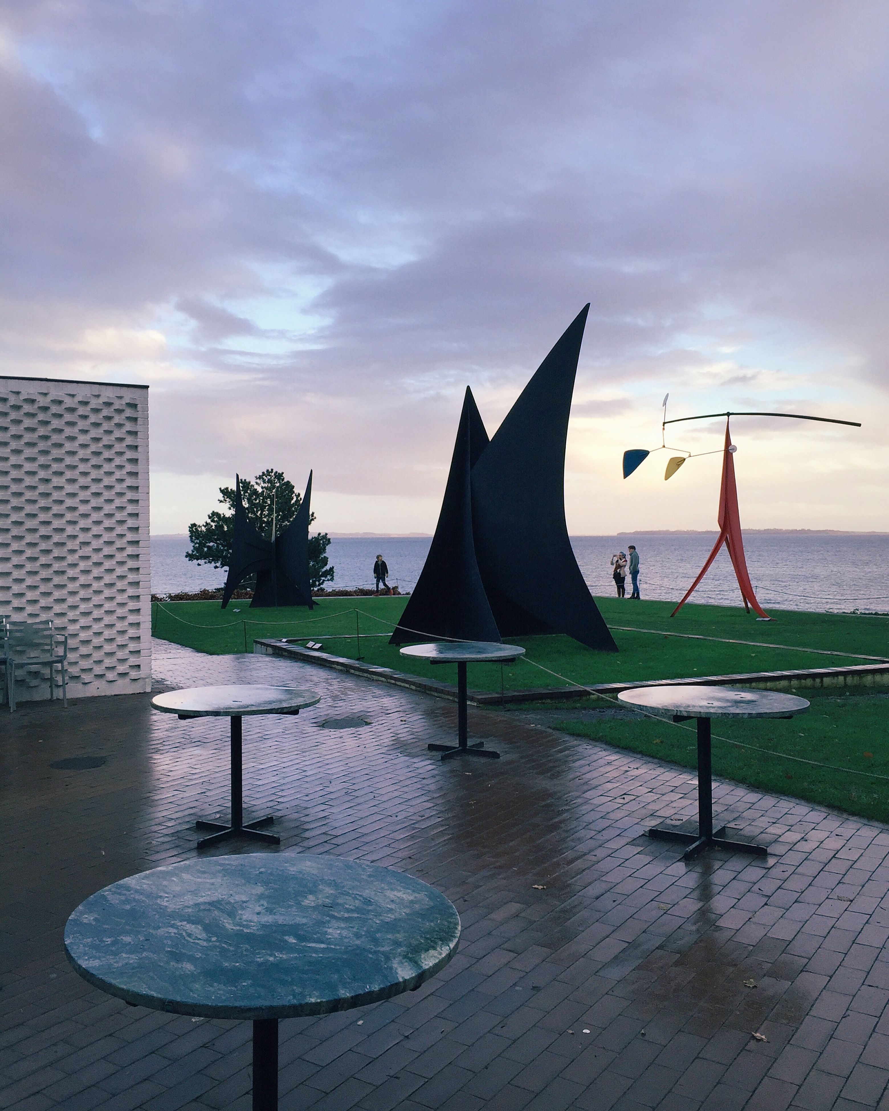 sky, water, sea, cloud - sky, built structure, cloud, nature, beach, architecture, sunlight, chair, tranquility, outdoors, horizon over water, absence, tree, cloudy, parasol, building exterior, sunset