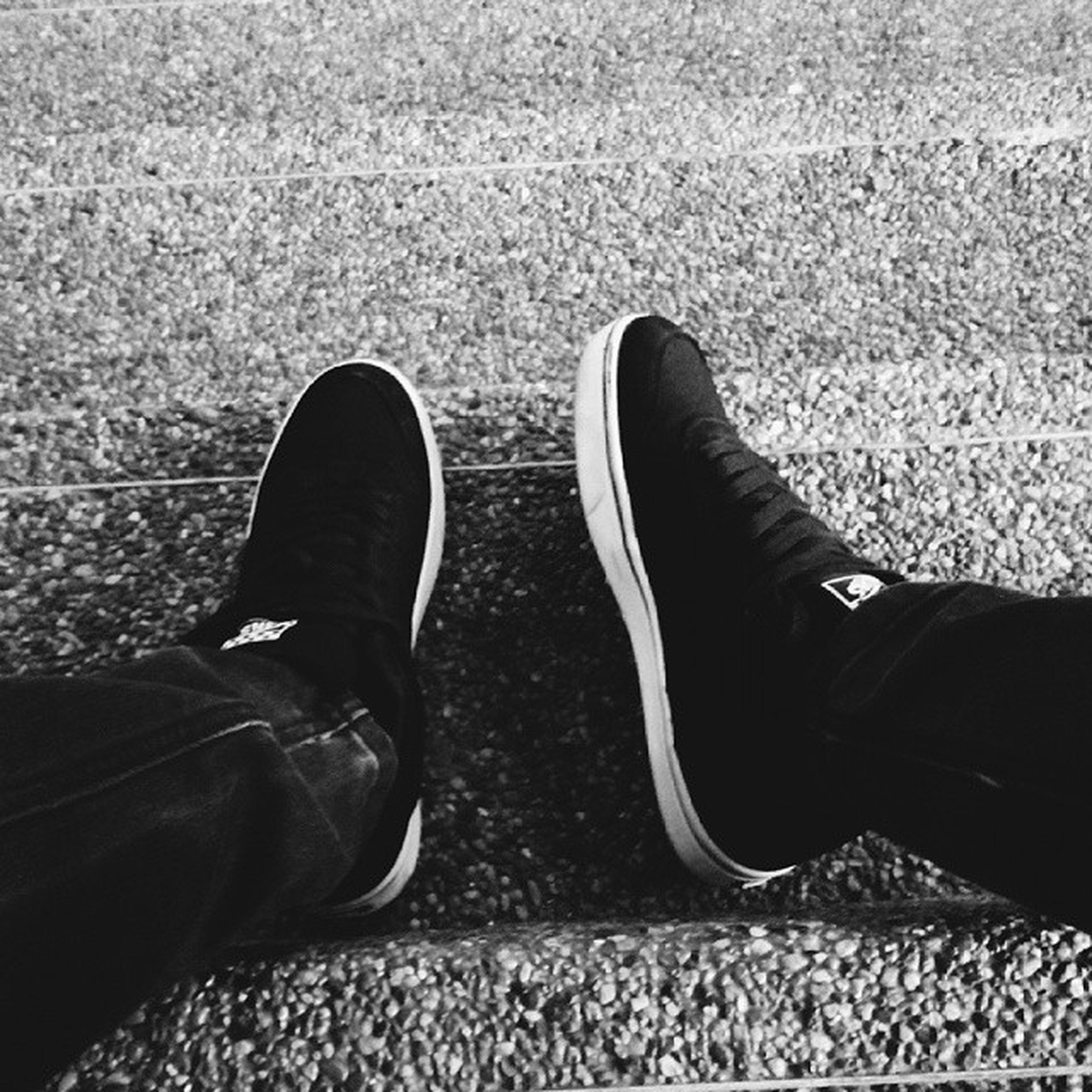 low section, person, shoe, personal perspective, footwear, jeans, human foot, lifestyles, standing, canvas shoe, high angle view, men, leisure activity, pair, human limb, part of, street
