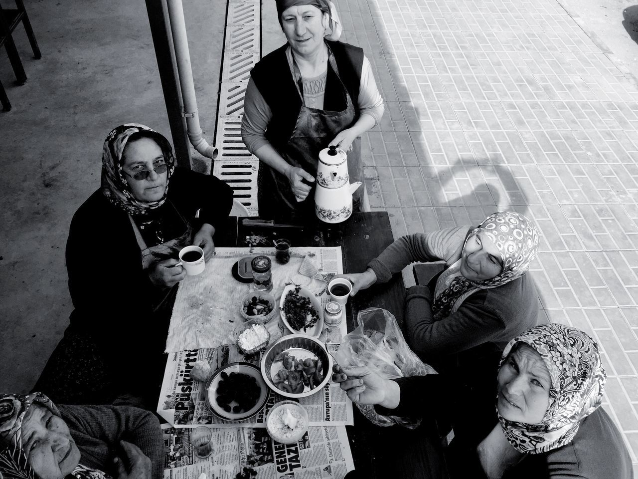Portrait Of Women Having Meal At Sidewalk Cafe