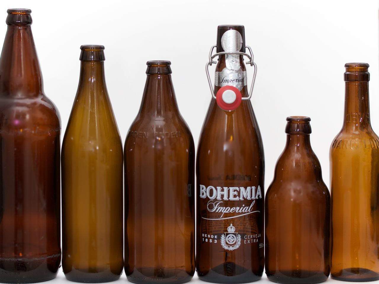 six brown bottles on white background Alcohol Beer Bottle Brown Bottles Day Food Food And Drink In A Row No People Studio Shot White Background