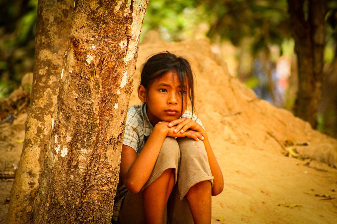 Cambodian Girl Tree Child Daydreaming Girl Lost In Thoughts Children Of The World Children Of Cambodia Cultures People Cambodia Social Issues Poverty Humanitarian Crisis Siem Reap, Cambodia Travel Photography People Photography Long Goodbye