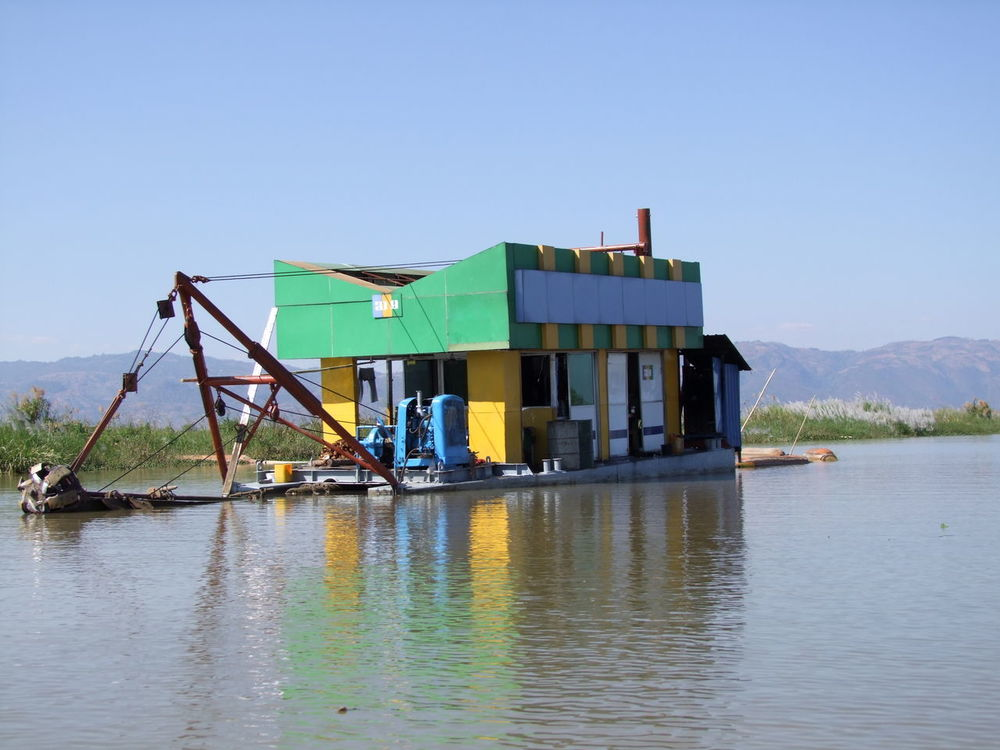 Dredging Platform & Equipment Blue Sky Composition Dredger Inle Lake Lake Machinery Myanmar No People Outdoor Photography Reeds At The Lake Reflections In The Water Ripples In The Water Shan State Sunlight And Shadow Tranquil Scene Water