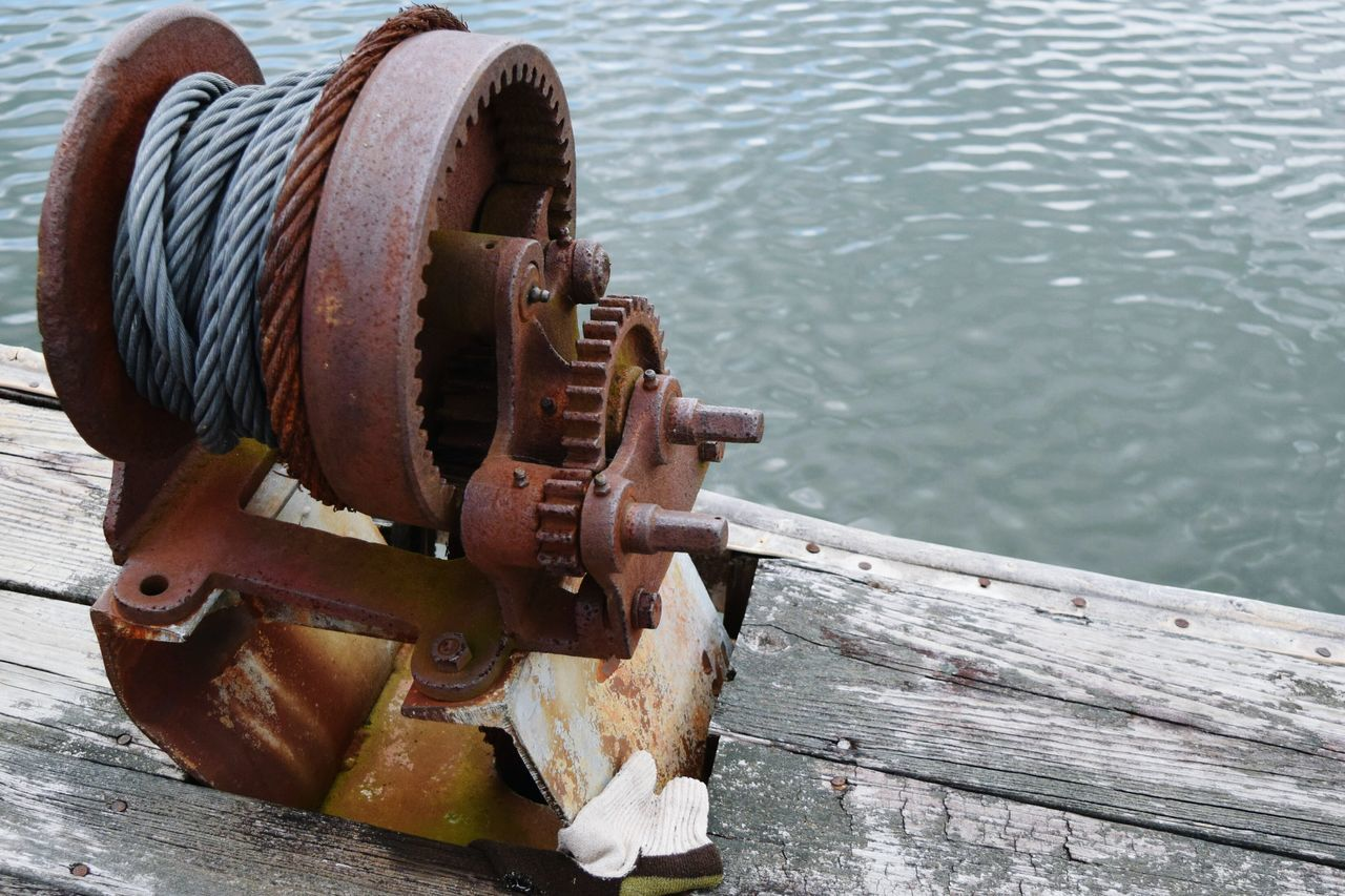 High Angle View Of Rusty Metal By Lake
