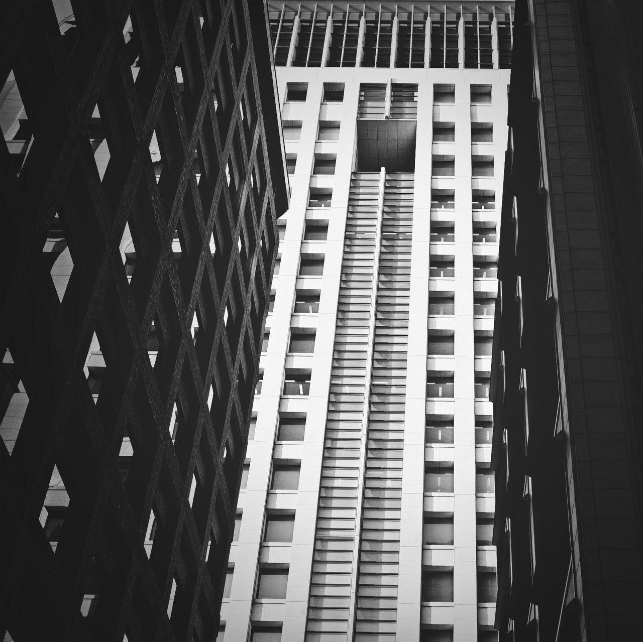 architecture, built structure, building exterior, modern, city, skyscraper, low angle view, no people, day, outdoors, growth