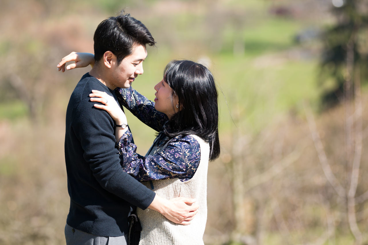 Bonding Bride Couple - Relationship Day Embracing Focus On Foreground Friendship Groom Happiness Heterosexual Couple Hugging Leisure Activity Lifestyles Love Men Nature Outdoors Real People Smiling Standing Togetherness Two People Women Young Adult Young Women